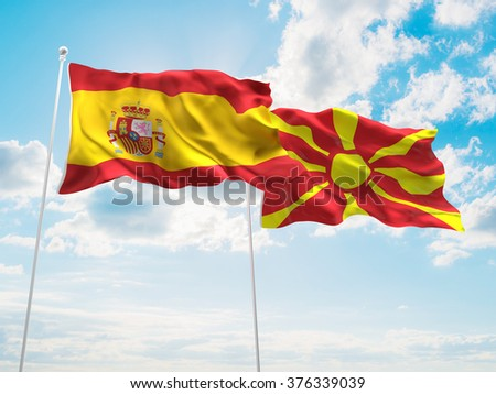 Spain & Macedonia Flags are waving in the sky