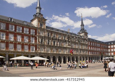 Spain,Madrid - May 27, 2016: Tourists walk around and sit at restaurants on the Plaza Mayor city square in Madrid, Spain on May 27, 2016