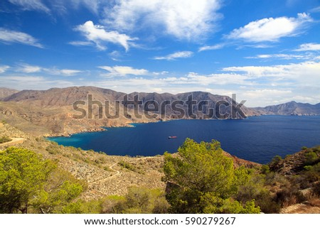Spain Murcia mountains, blue sea and ship, Costa del Sol