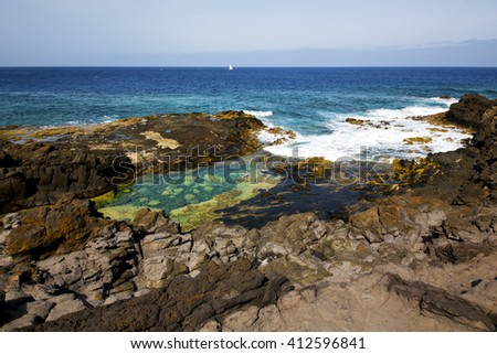 spain musk pond beach  water yacht boat coastline and summer in lanzarote  - stock photo