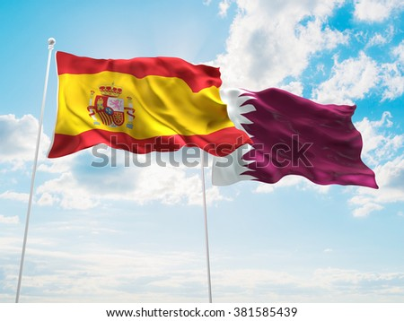 Spain & Qatar Flags are waving in the sky