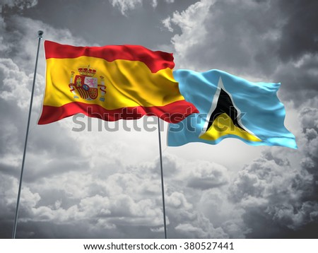 Spain & Saint Lucia Flags are waving in the sky with dark clouds