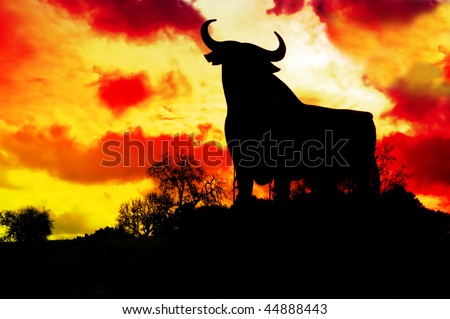 spain,silhouette of a bull in the field in Spain - stock photo