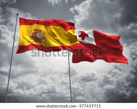 Spain & Tonga Flags are waving in the sky with dark clouds