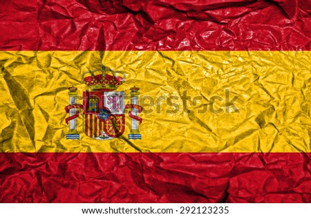 Spain vintage flag on old crumpled paper background - stock photo