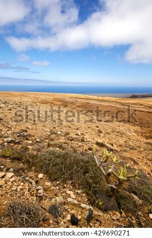 spain volcanic timanfaya  rock stone sky  hill and summer in los volcanes lanzarote  - stock photo