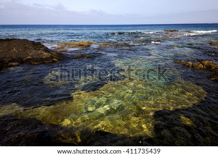 spain  water coastline  in lanzarote  sky cloud beach  and summer  - stock photo