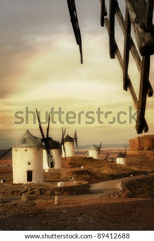 Spain, windmills on sunset, artistic toned picture - stock photo
