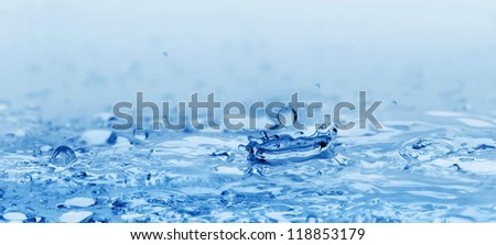 Spalsh watyer.High-speed shooting, a blue background - stock photo