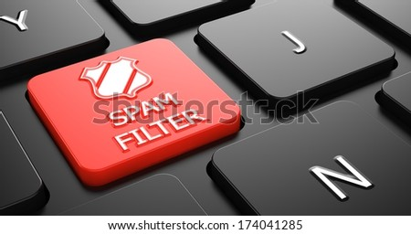 Spam Filter with Shield Icon - Red Button on Black Computer Keyboard. - stock photo