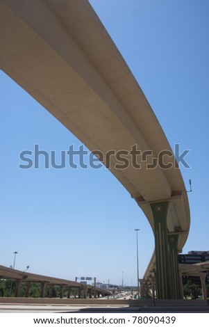 Span of bridge over an interstate highway - stock photo