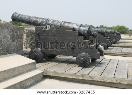 Spanish American fortress cannons on top fort deck - series 02 - stock photo