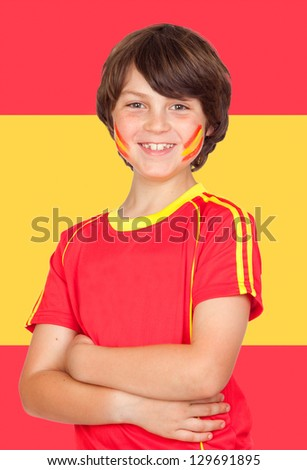 Spanish boy with t-shirt team and Spain flag of background - stock photo