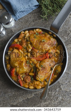 Spanish chicken and chorizo with cannellini beans - stock photo