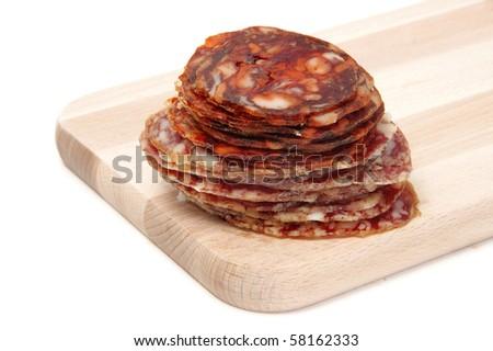 spanish chorizo and salami  on a cutting board - stock photo