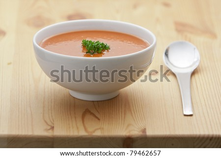 Spanish cold tomato based soup gazpacho served in a white bowl - stock photo