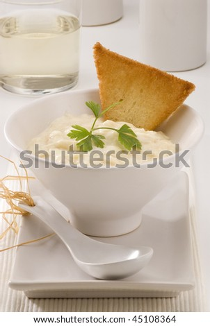 Spanish Cuisine. Brandada de bacalao. Salt cod with mashed potatoes. Selective focus. White background. - stock photo