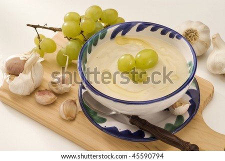 Spanish cuisine. Chilled garlic soup Andalusian style. Selective focus. Ajoblanco.