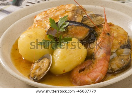 Spanish cuisine. Seafood stew Costa Brava style. Selective focus. Suquet de peix. - stock photo