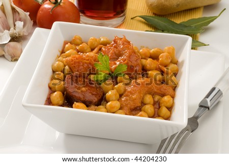 Spanish cuisine.Stewed tripe and chickpeas, Madrid style. Served in a ceramic plate. Selective focus. Callos con garbanzos.