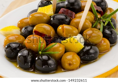 Spanish cuisine. Tapas. Marinated Olives in a white plate.Selective Focus. - stock photo