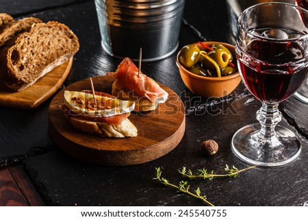 Spanish dinner cooked and served on the table - stock photo