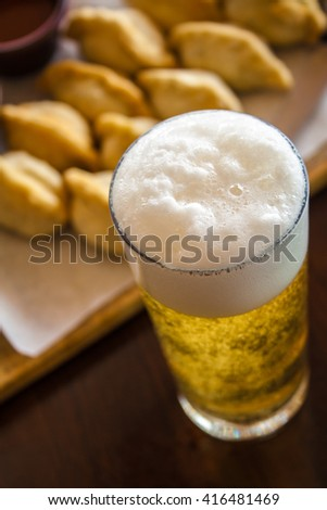 Spanish Empanadas with dark and light beer in a pub - stock photo