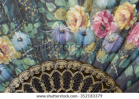Spanish fan with authentic pattern, flowers on the fan. - stock photo