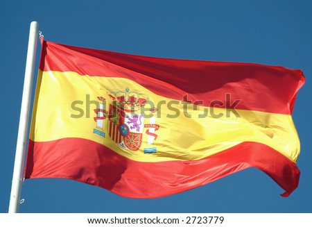 Spanish flag waving to the wind against the sky - stock photo