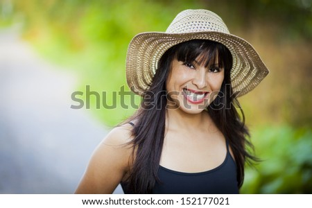 Spanish Girl Smiling Outside - stock photo