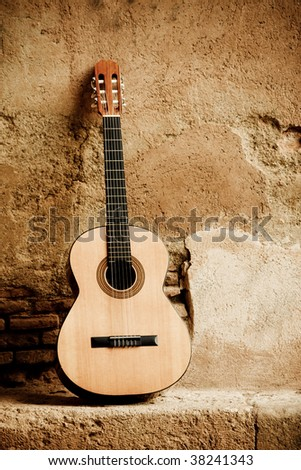 Spanish guitar on old wall
