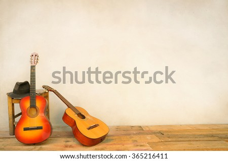 Spanish guitars propped in front of a white wall as background