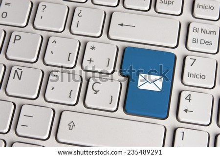Spanish keyboard with email concept mail envelope icon over blue background button. Image with clipping path for easy change the key color and editing.