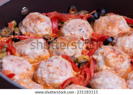 Spanish Meatballs albondigas with vegetables in black pan. Close up. - stock photo