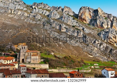 Spanish Medieval City on the Background of Rocky Mountains