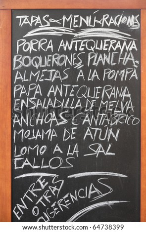 Spanish menu of tapas in Antequera, Andalusia. Typical cuisine of Spain. - stock photo