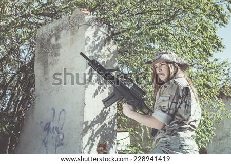 Spanish military girl with his machine gun - stock photo