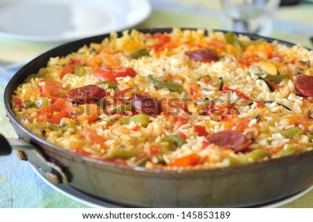 Spanish paella in a pan - stock photo