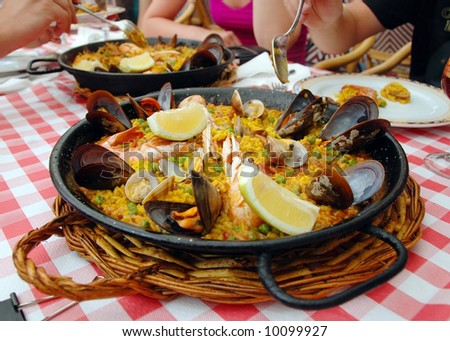 Spanish paella in pan - stock photo