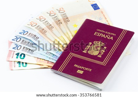 Spanish passport with european union currency banknotes on a white background