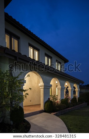 Spanish porch of this Mediterranean house at night. - stock photo
