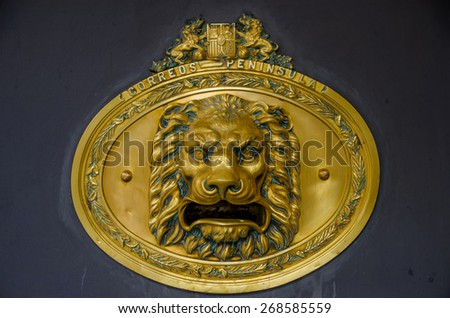 Spanish post box retro styled with a lion head as mailbox - stock photo