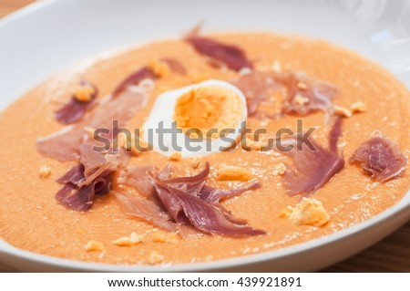 "Spanish ""salmorejo"" gazpacho soup: delicious cold tomato soup served in summer. - stock photo"