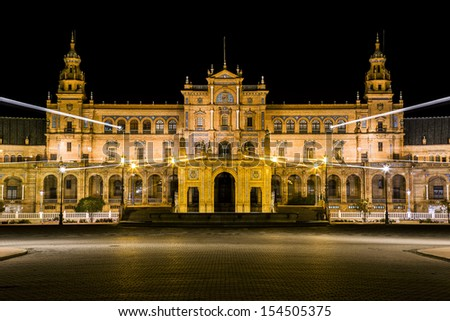 Spanish Square (Plaza de Espana) in Sevilla at night with photographic technique zooming. Spain - stock photo