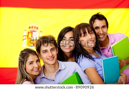 Spanish students with the flag of Spain at the background - stock photo