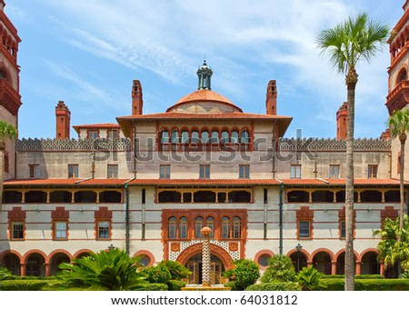 Spanish style historic building against a cloudy blue sky  in St. Augustine, Florida - stock photo