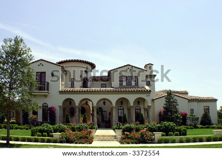 spanish style home with arches - stock photo