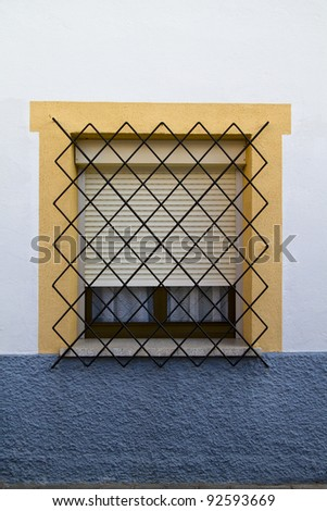 Spanish style window, in white house
