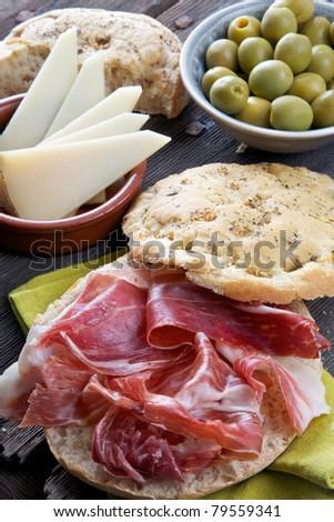 spanish tapas, iberian ham, manchego cheese and olives - stock photo
