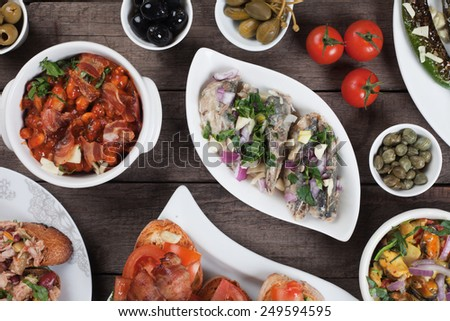 Spanish tapas or antipasto food, cold buffet appetizers - stock photo